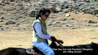 Daw Suu Kyi and President Elbegdorj are riding horses